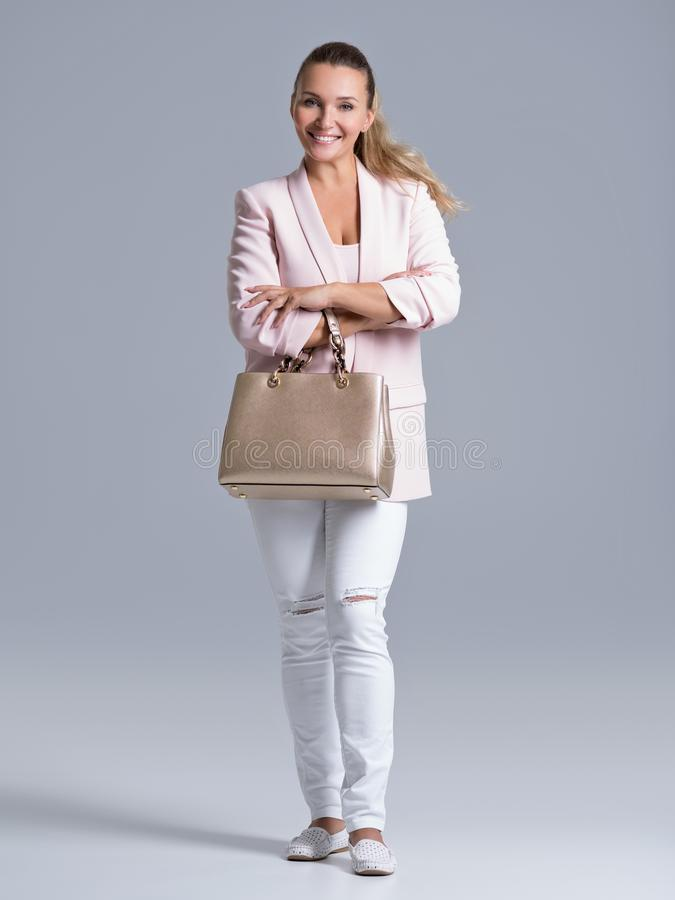 Portrait of an young happy woman with handbag stock photo