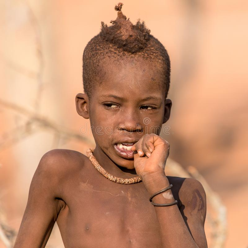 Portrait of a young Himba boy, Epupa falls, Namibia royalty free stock images