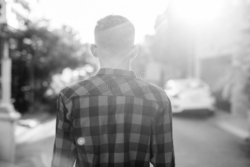 Portrait of young hipster man in the streets outdoors stock photo