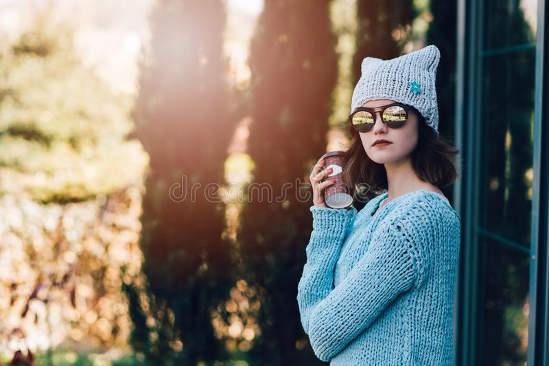 Portrait of young hipster woman with coffee paper mug stock image