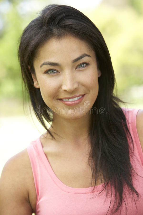 Portrait Of Young Hispanic Woman In Park Royalty Free Stock Image