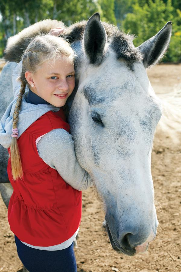 Portrait of young horsewoman and brown horse. Girl with horse royalty free stock photo
