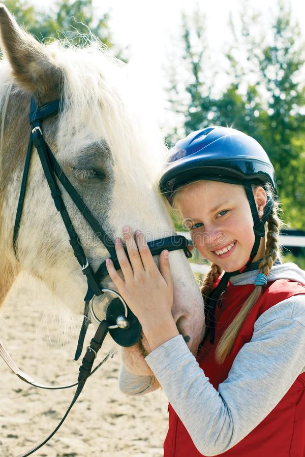 Portrait of young horsewoman and brown horse. Girl with horse royalty free stock photos