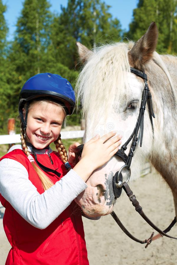 Portrait of young horsewoman and brown horse. Girl with horse stock images
