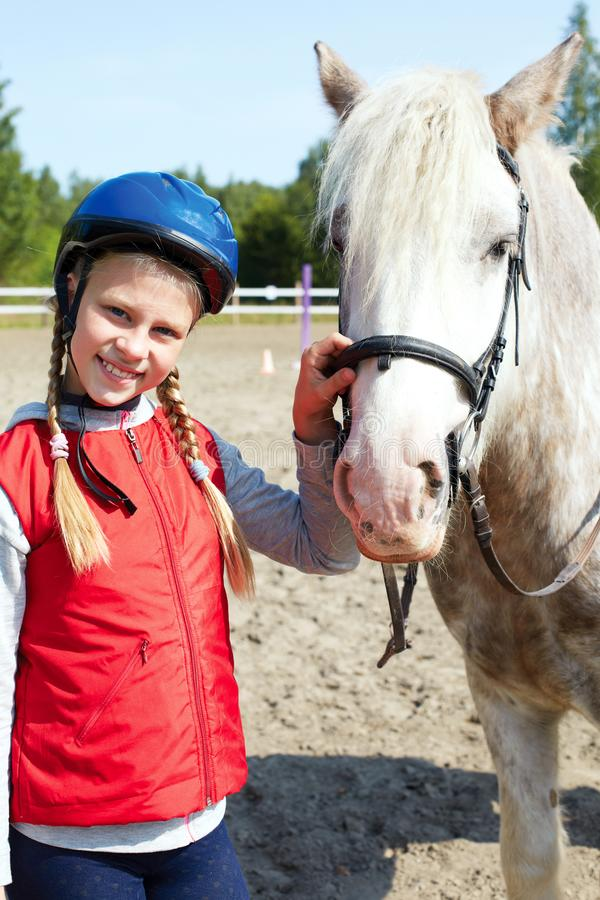 Portrait of young horsewoman and brown horse. Girl with horse stock image