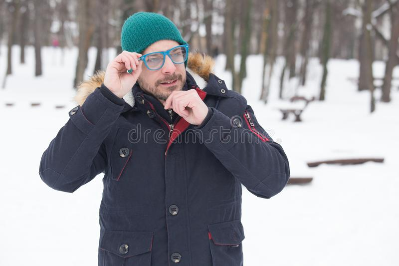 Portrait of a young imaginary man holding his beard and thinking royalty free stock images