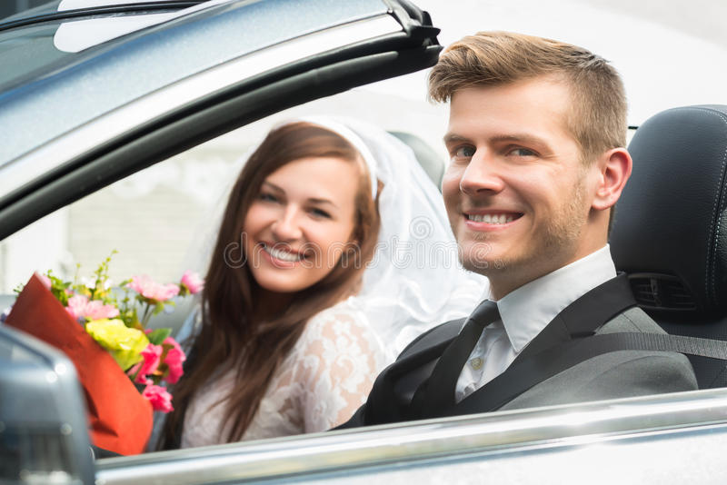 Young Just Married Couple In Car. Portrait Of Young Just Married Couple In The Car stock photography