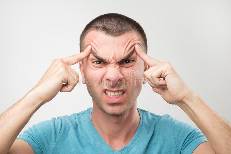 Portrait of young latin angry man. He is furious and shout with anger. Close up portrait of young latin angry man. He is furious and shout with anger. Concept of royalty free stock photo