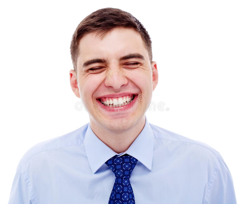 Portrait of young laughing businessman royalty free stock photo