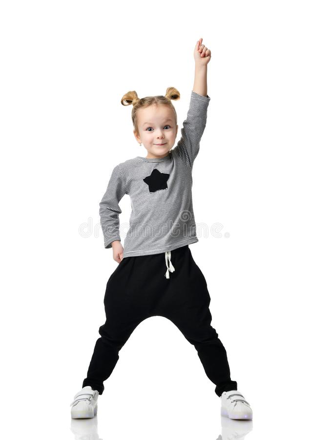 Portrait of young little girl having a brilliant idea pointing finger up stock photography