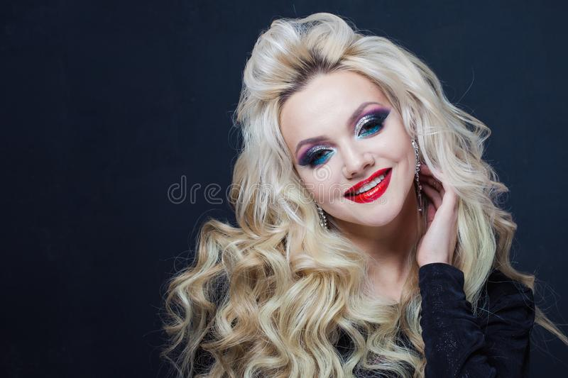 Portrait of a young luxurious blonde with long curls. royalty free stock photo