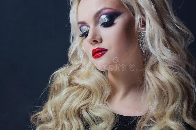 Portrait of a young luxurious blonde with long curls. stock image