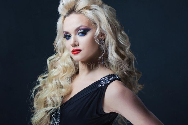 Portrait of a young luxurious blonde with long curls. stock photos