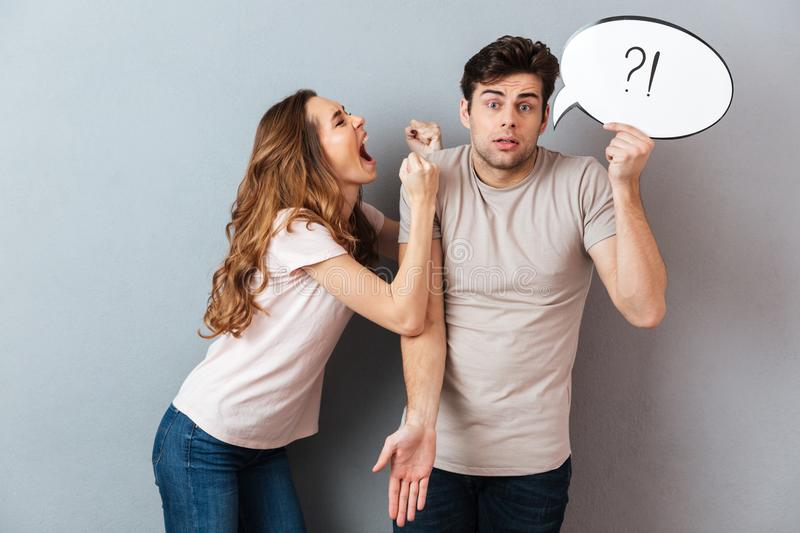 Portrait of a young mad couple having an argument royalty free stock images