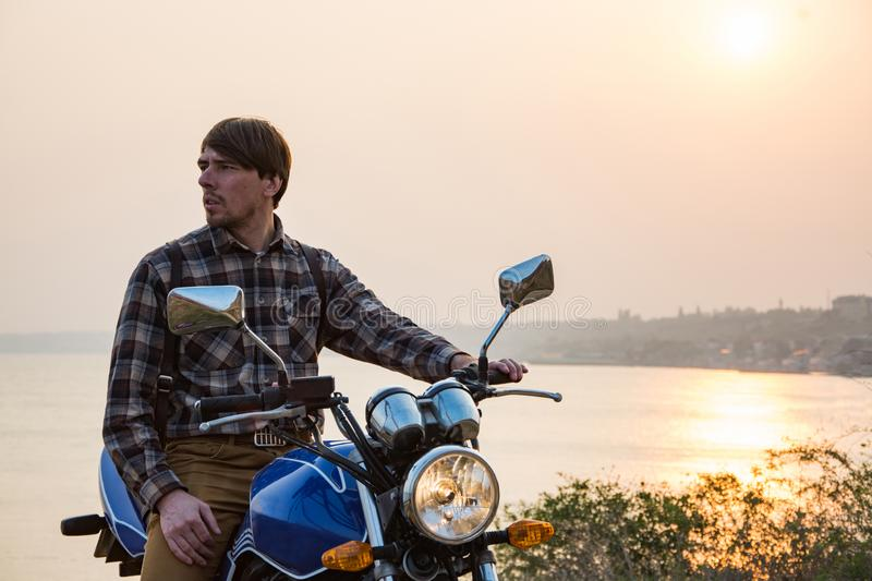 Portrait of young male biker in summer day stock photography