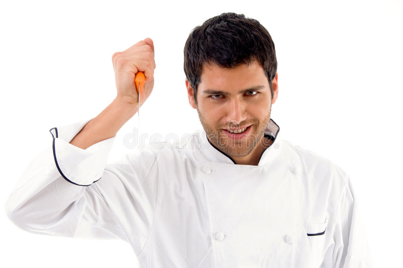 Download Portrait Of Young Male Chef Holding Dagger Stock Photo - Image: 7420234