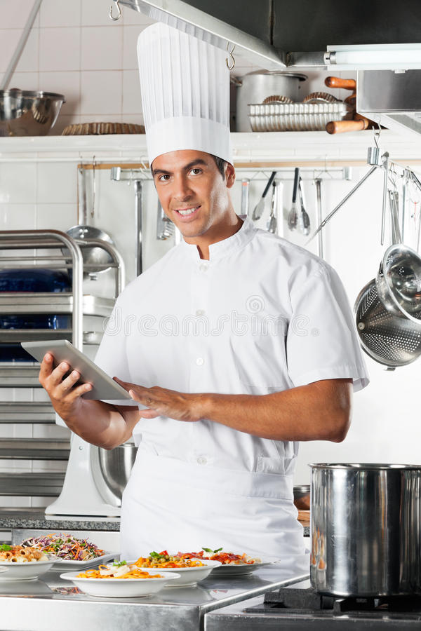 Young Chef Holding Tablet