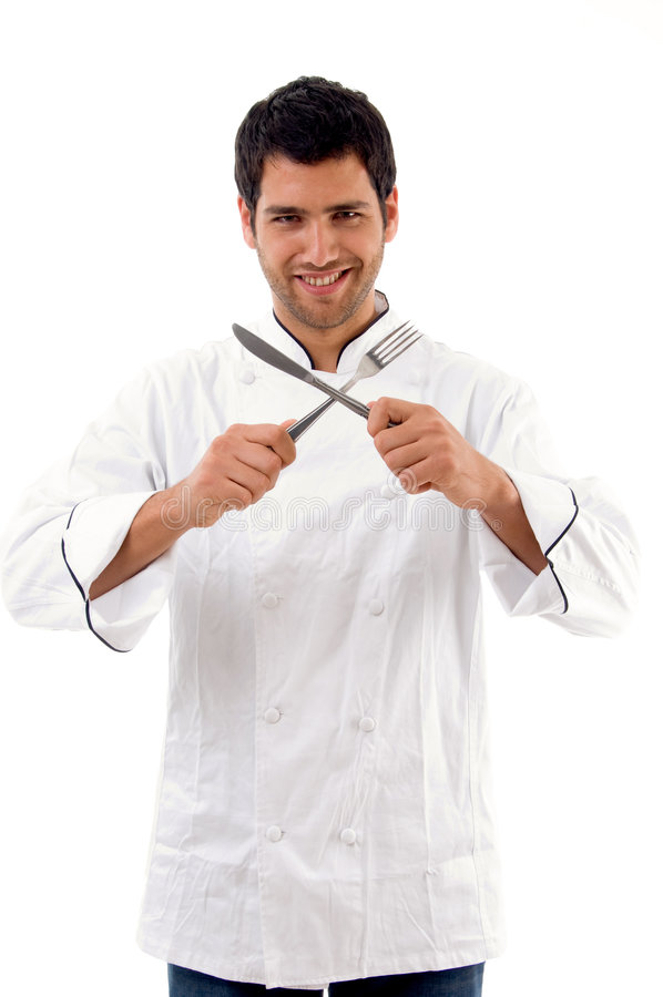 Download Portrait Of Young Male Chef Holding Fork And Knife Stock Image - Image: 7417991
