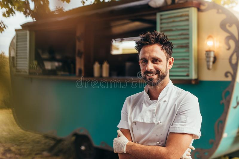 Happy young food truck owner royalty free stock photos