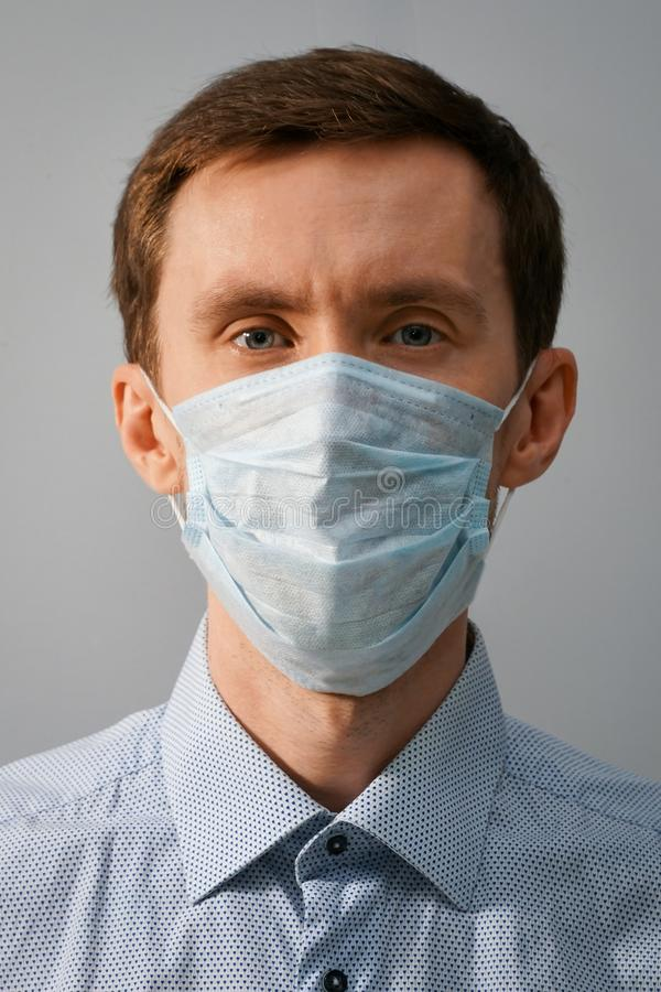 Portrait of a young male doctor in a medical mask royalty free stock photos