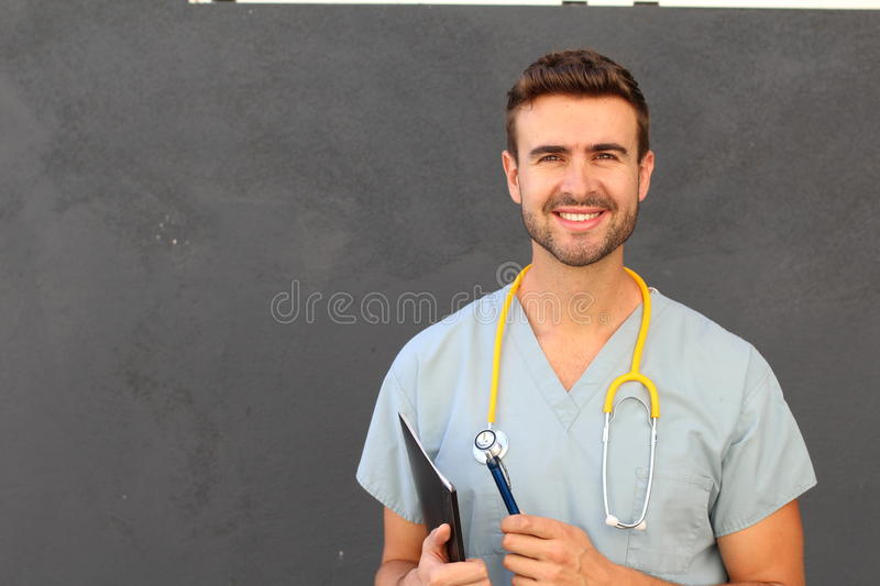 Portrait of young male nurse in scrubs smiling stock photo