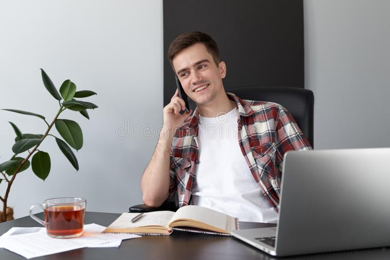 Portrait of a young male programmer student freelancer working a royalty free stock photos