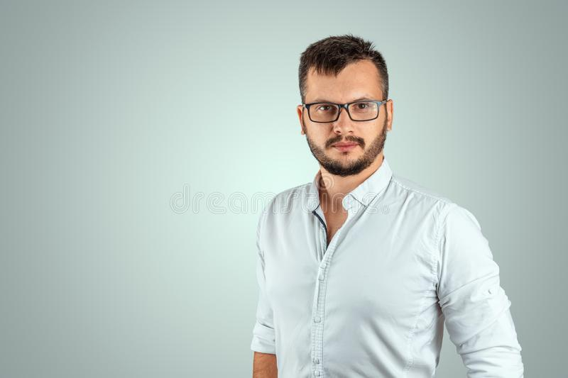 Portrait of a young male teacher on a light background. Teacher`s Day Knowledge Day back to school study online learning royalty free stock photo
