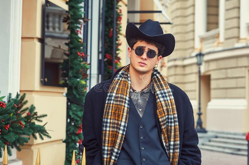 Portrait of a young man in the autumn city . royalty free stock image