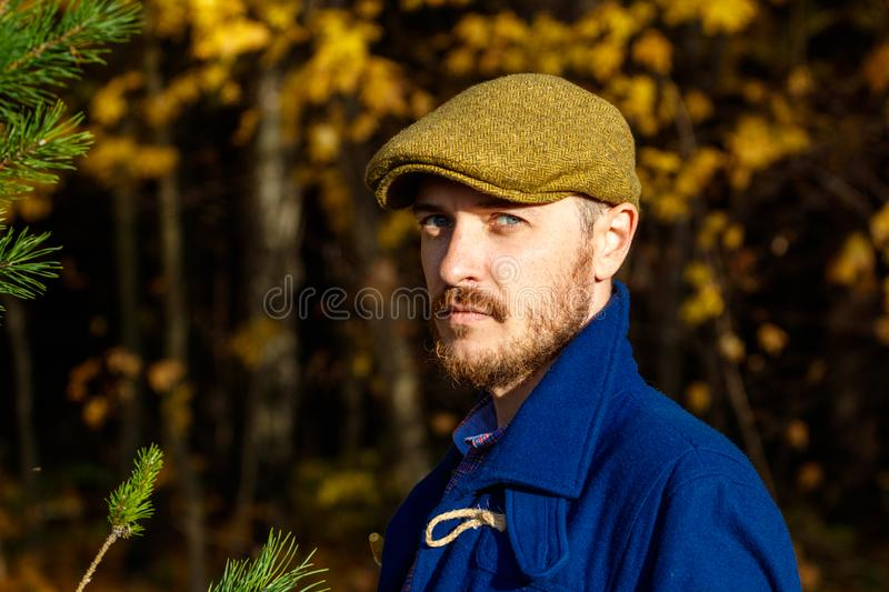 Portrait of young man in autumn forest stock image