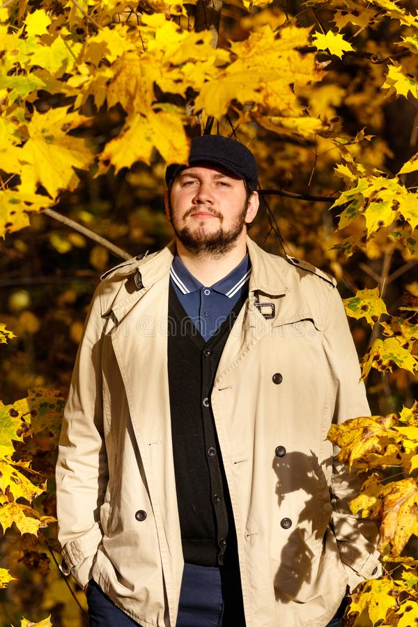 Portrait of young man in autumn forest stock photo