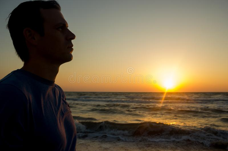 Portrait of a young man on the beach stock image