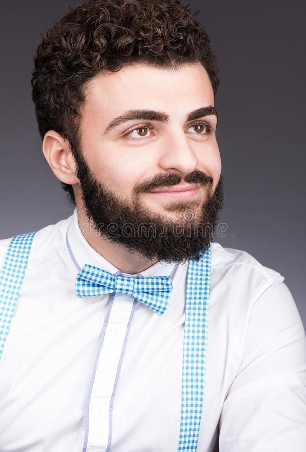 Portrait of a young man with a beard and mustache. Stylish appearance, bow tie stock photo