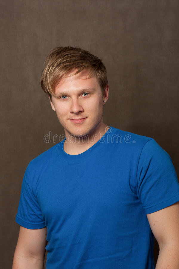 Portrait of a young man in a blue t-shirt royalty free stock photography