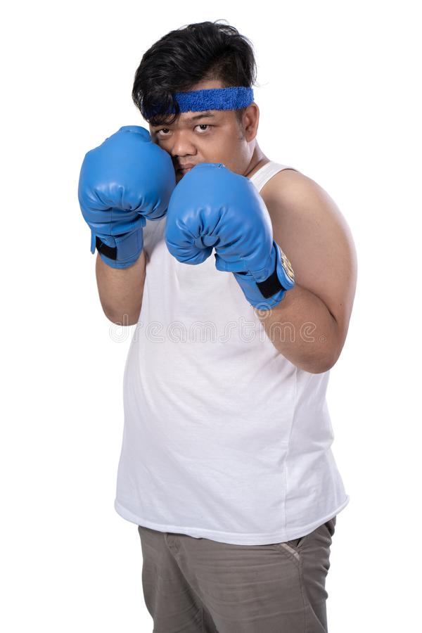 Portrait young man with boxing gloves defend from enemy. Look camera stock photography
