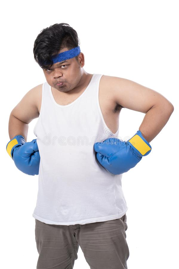 Portrait of young man with boxing gloves and mouth guard stock photo
