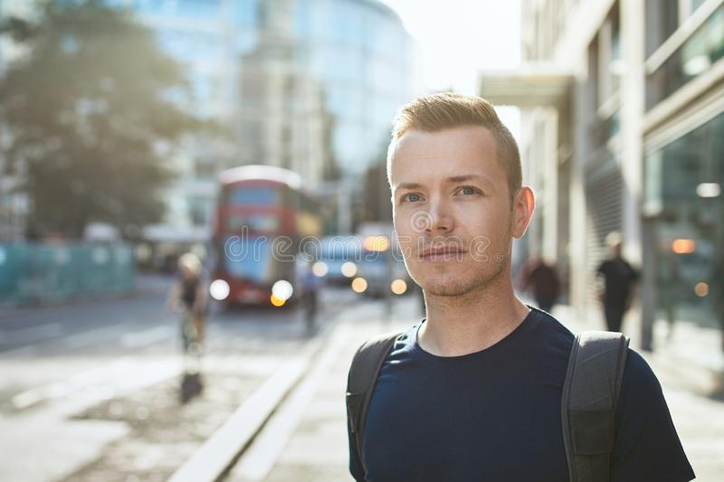 Portrait of young man on city street royalty free stock images