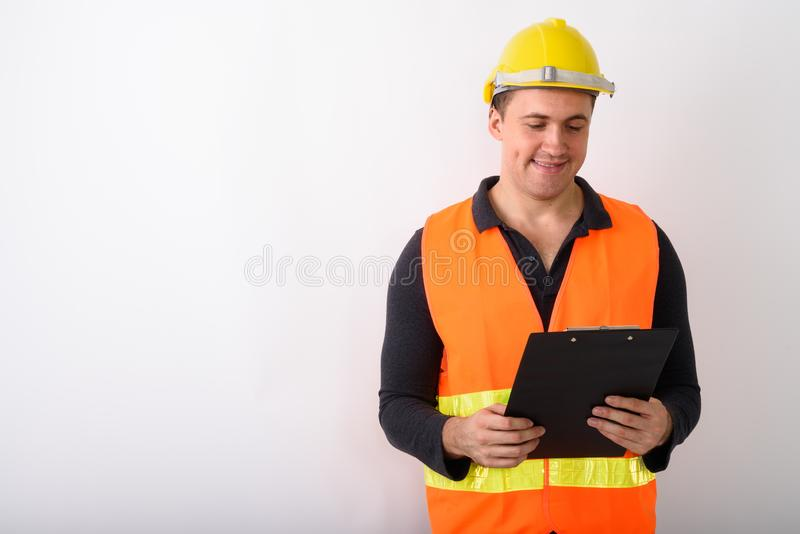 Portrait of young man construction worker standing stock images