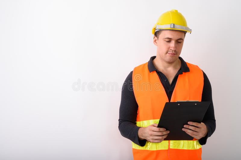 Portrait of young man construction worker standing stock photos