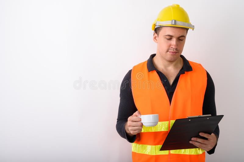 Portrait of young man construction worker standing royalty free stock photos