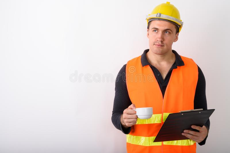 Portrait of young man construction worker standing royalty free stock photo