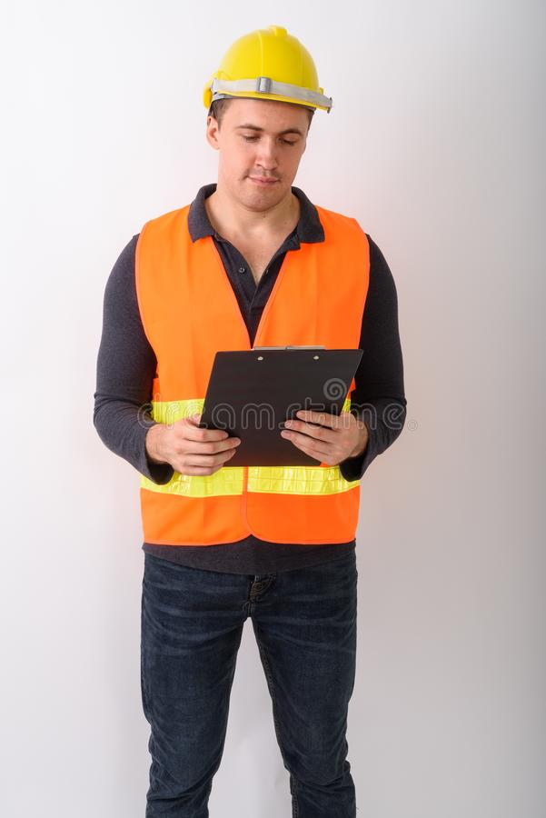 Portrait of young man construction worker standing stock photography