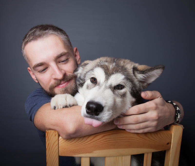 Portrait of a young man with a dog.  stock images