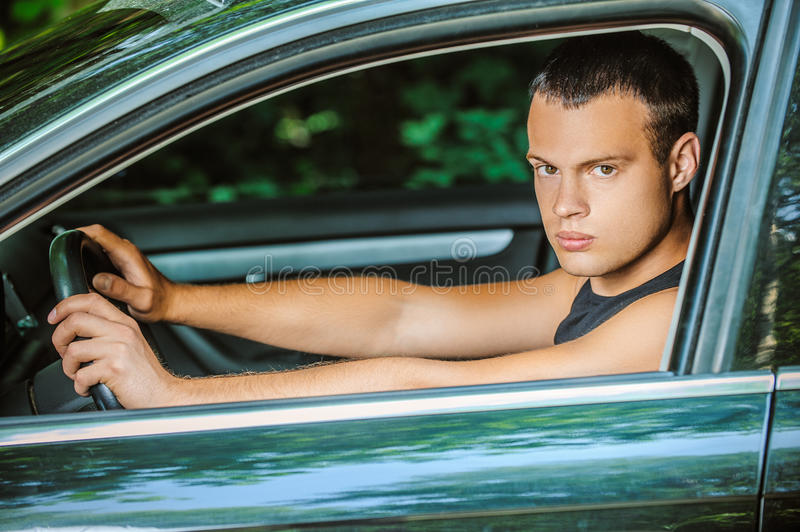 Portrait of young man driving car royalty free stock images