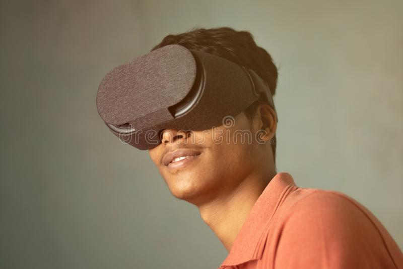 Portrait of a young man experiencing virtual reality through a VR headset. Portrait of a young man experiencing virtual reality through a VR headset stock photos