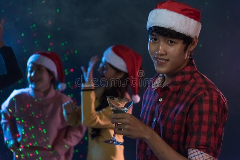 Portrait young man and Group Asian young friends Enjoying Dance. Portrait young men and Group Asian young friends Enjoying Dance on back, Christmas or New Year royalty free stock image