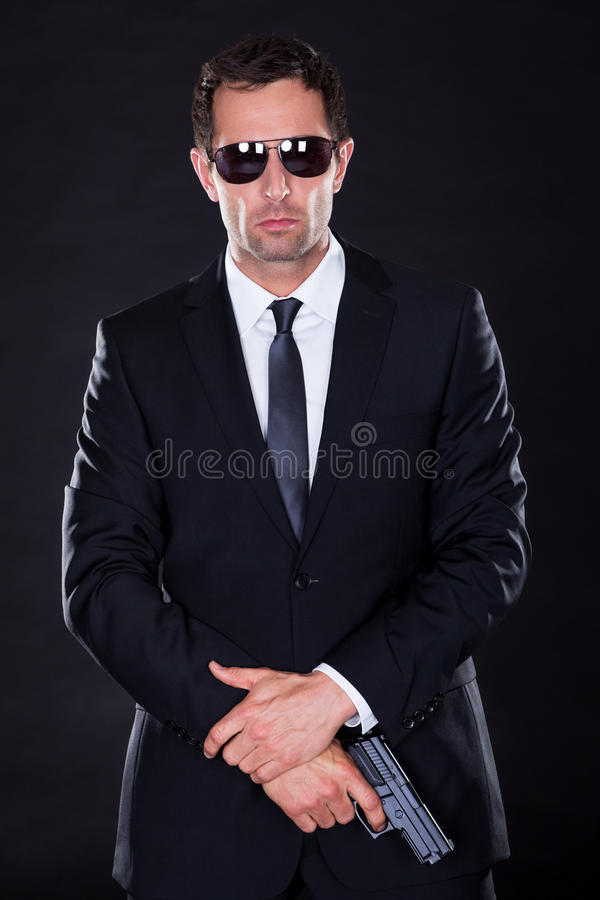 Portrait Of Young Man With Gun stock image
