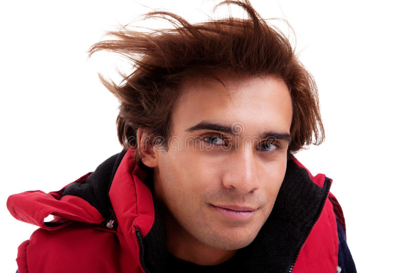 Portrait of a young man with hair on the wind royalty free stock images