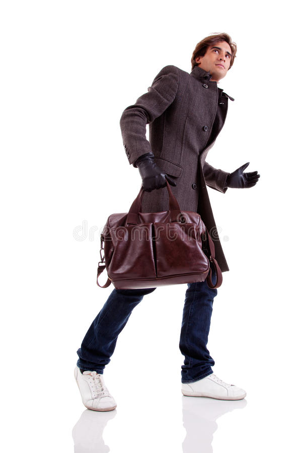Portrait of a young man with a handbag, hasty royalty free stock photo