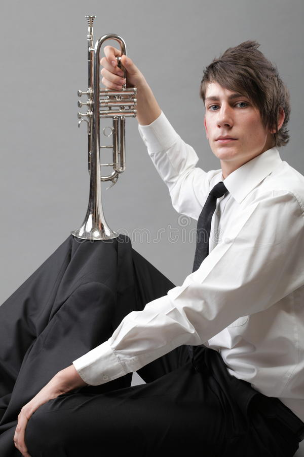 Download Portrait Of A Young Man And His Trumpet Stock Photo - Image: 27338646