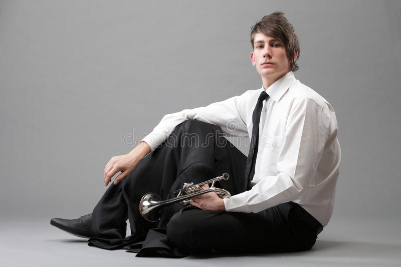Portrait Of A Young Man And His Trumpet Royalty Free Stock Photography